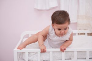 what should I do if my baby climbs out of the crib