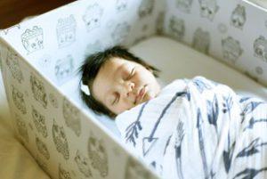 Newborn baby sleeping in a Baby Box