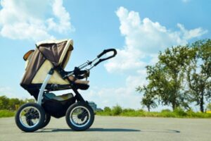 naps on the go - image of a stroller in the middle of a path