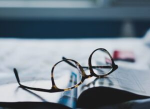 Reading glasses laying on a book
